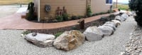 paver walkway with boulder flower bed